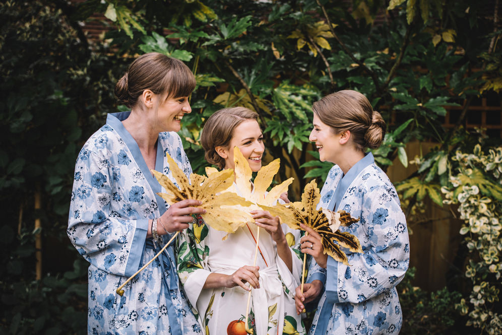 bride and bridesmaids wedding photo in the morning, wearing dressing gowns